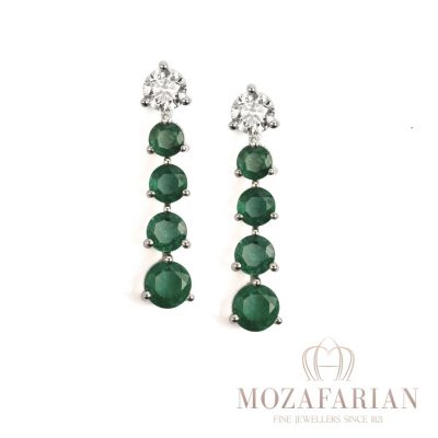 One of Mozafarians current featured designers, Facet 18ct White Gold Earrings with 0.77 ct White Diamonds and Emeralds. Weight: 4.4 g